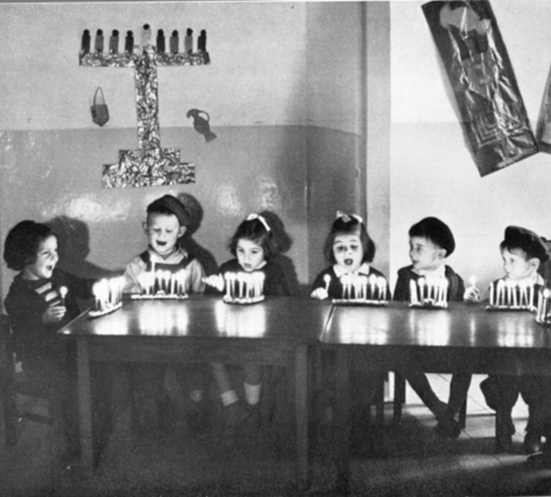 Young children light candles sometime between 1940 and 1951