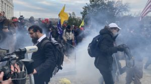 Security forces respond with tear gas after the US President Donald Trumps supporters breached the US Capitol