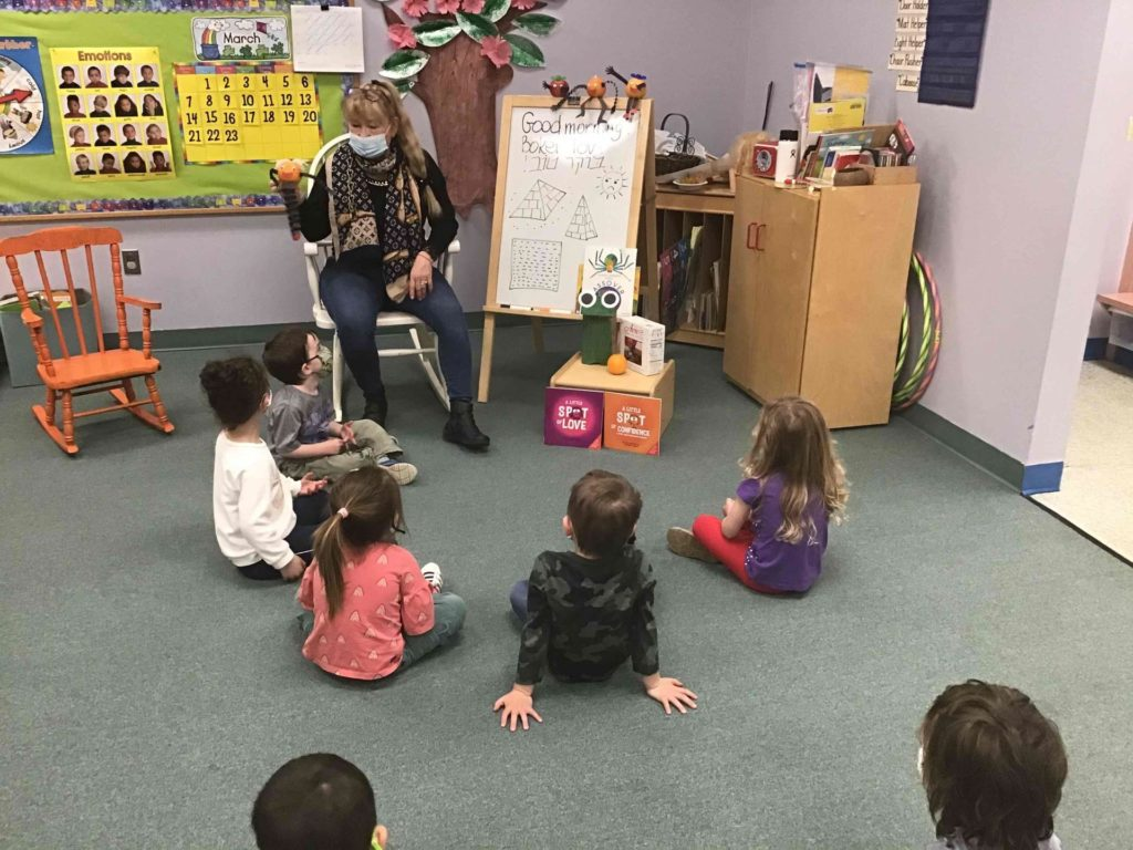 Teacher Irina Minevich work with E.B. Hirsh Early Childhood Center children