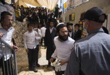 Mourners at the funeral of someone who died at the Lag B'Omer stampede