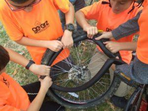 Geerz children repair a bike