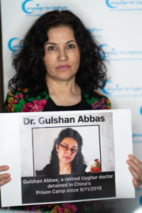 Rushan Abbas holds a picture of her sister
