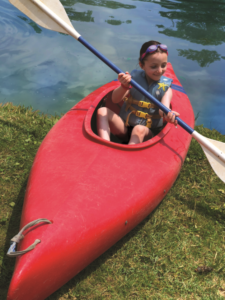 Beth Tfiloh camper in a canoe