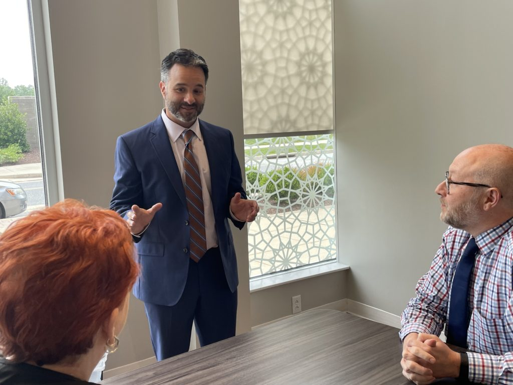 Realtor Eric Black meets with clients at Northrop Realty's Quarry Lake location