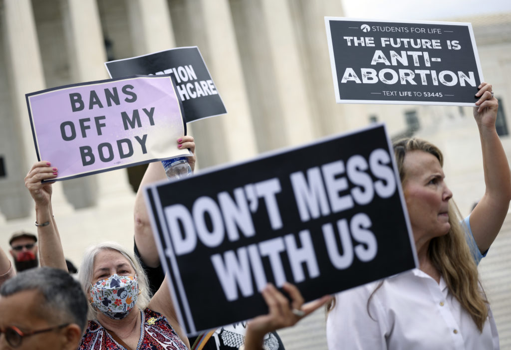 Pro-choice and anti-abortion protesters