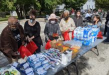Volunteers pack Blessing Bags for people experiencing homelessness