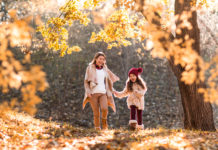 Mom and daughter in fall foliage